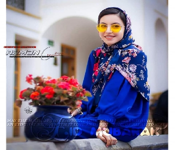 cute-girl-celebrating-eid-in-blue-dress-with-glasses